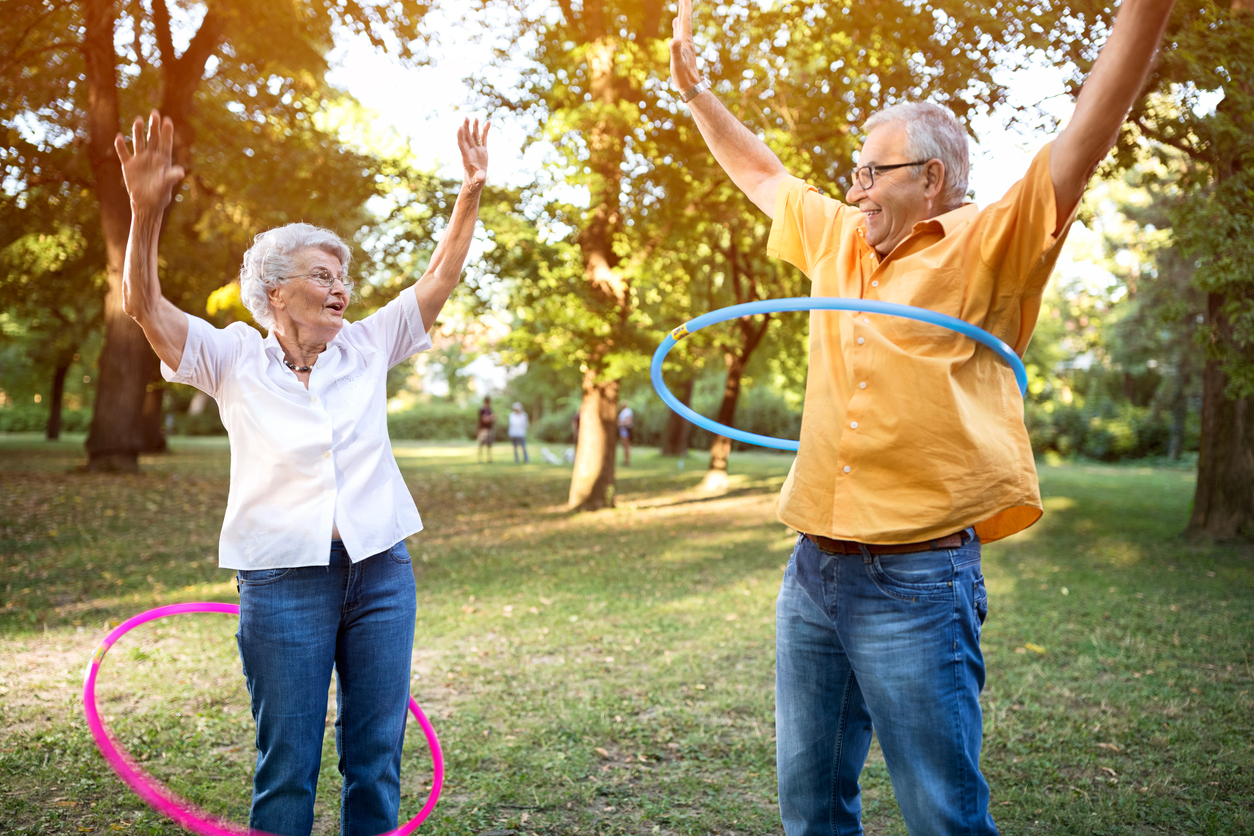 Older couple hula hooping