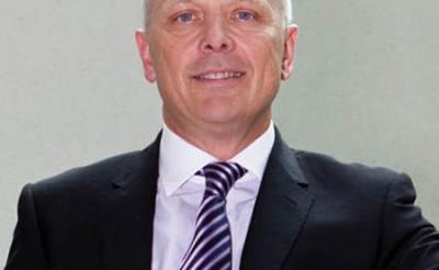 Photo of John Derrick - CEO of Grosvenor Place