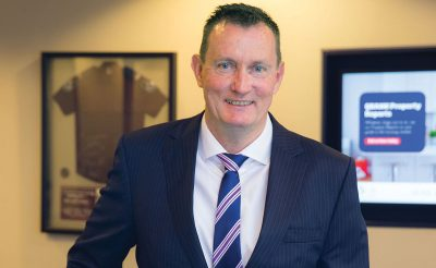 Mike Currie CEO of QBANK