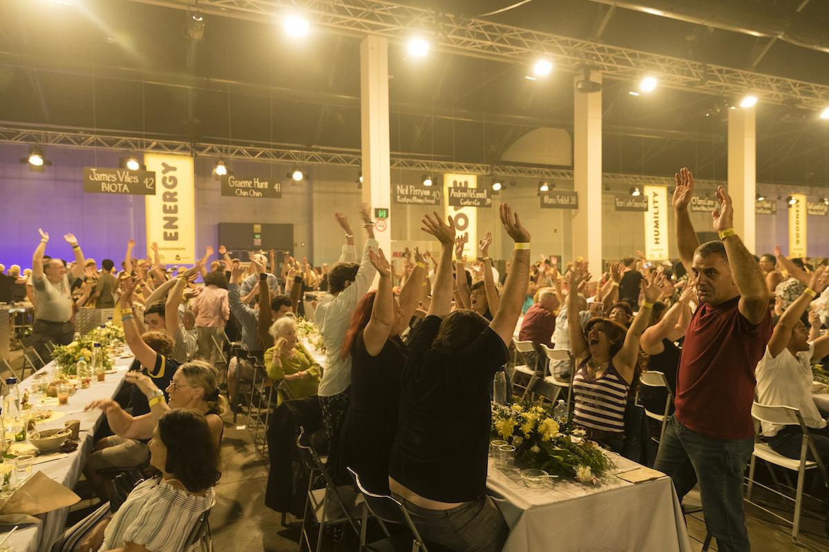 Crowd raising hands