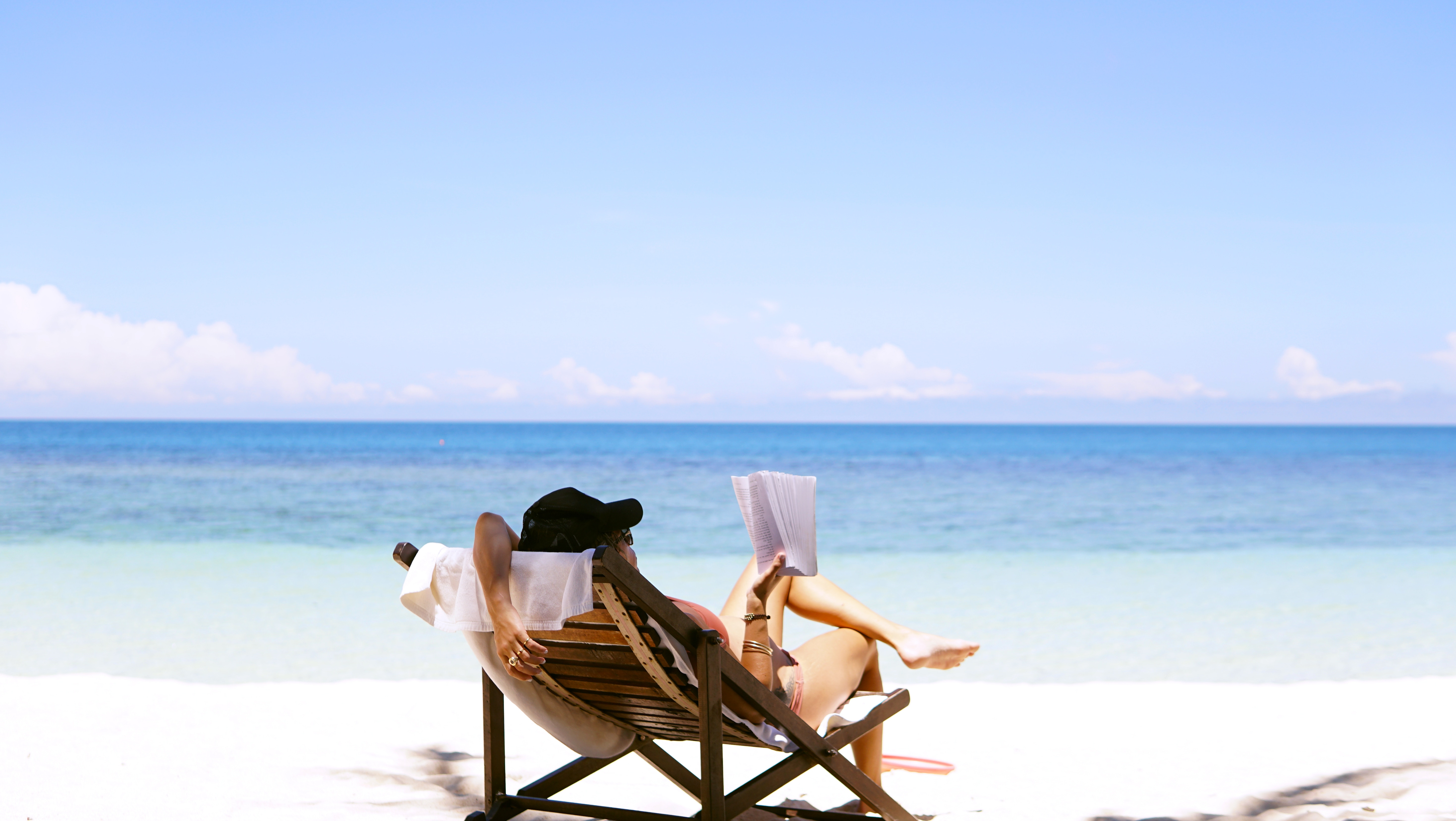 Someone relaxing on a beach holiday