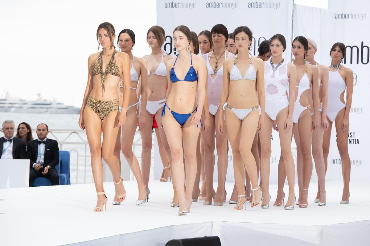 swimwear models on the runway
