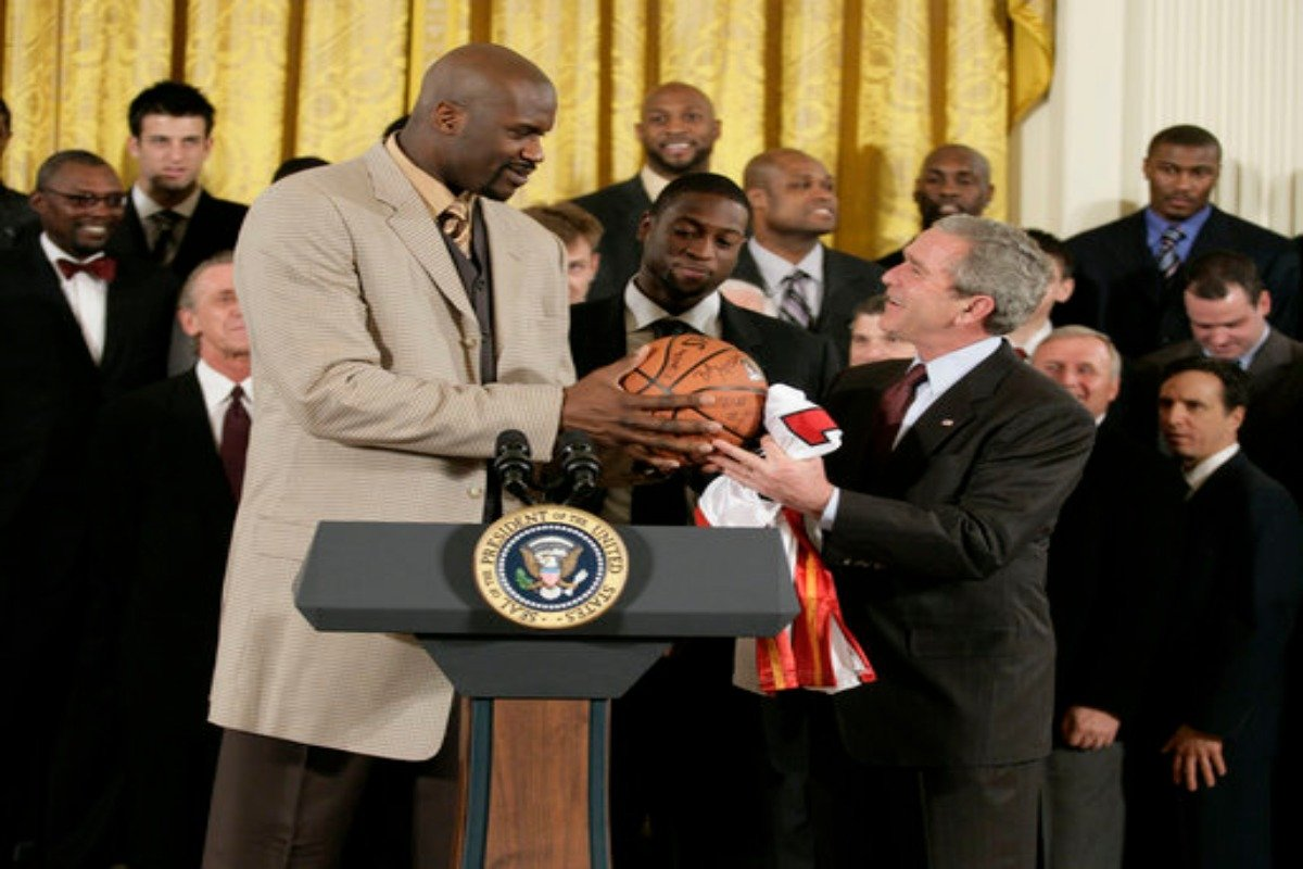 US President George W Bush welcomes Shaquille O'Neal as part of the 2006 NBA Champions Miami Heat basketball side to the White House.