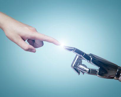 Human finger touches AI robot finger
