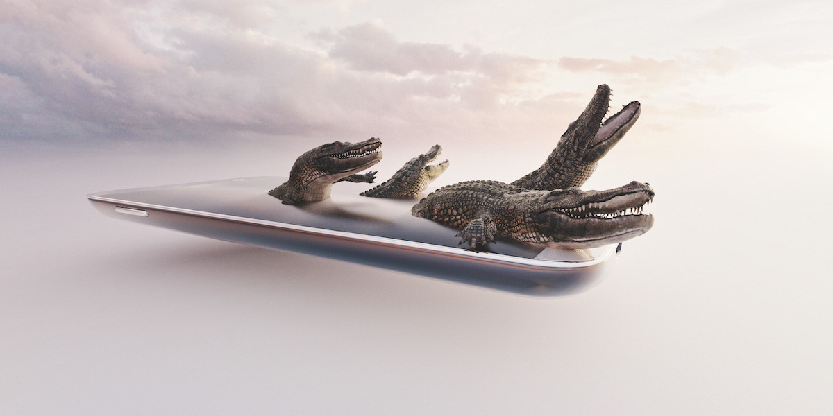 Alligators climbing out of mobile phone screen