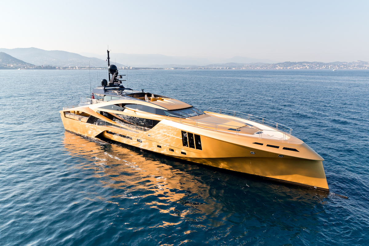 The gold exterior of the Khalilah superyacht at the 2019 Monaco Yacht Show