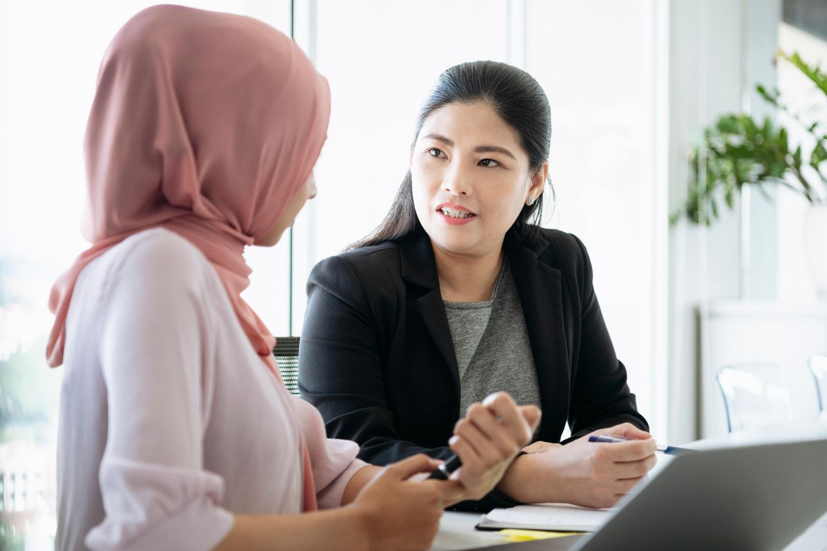 Business women having a conversation, a simple step to tackle turnover