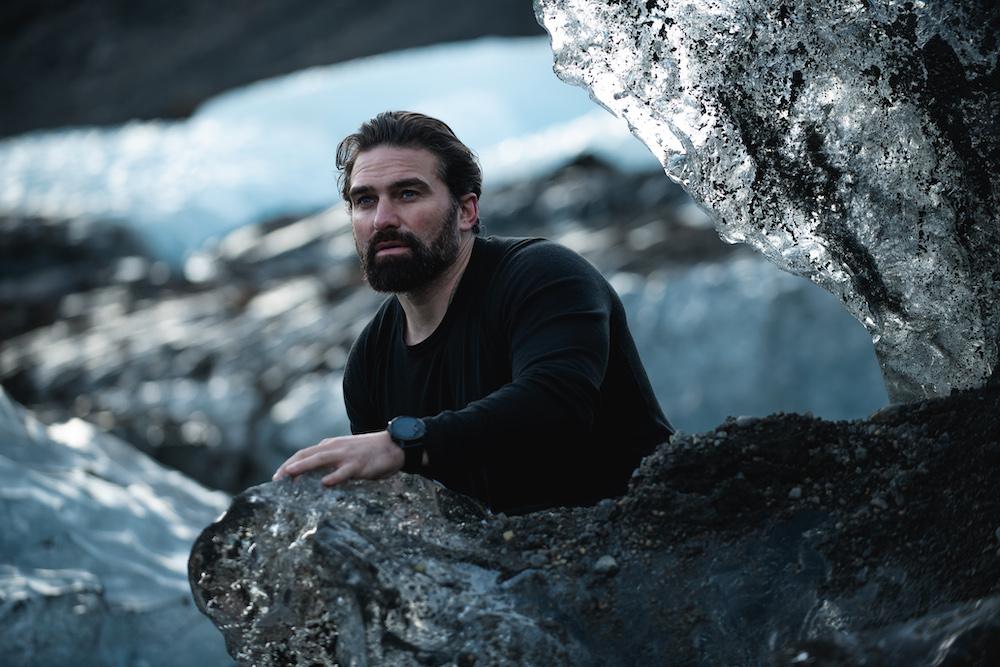 Middleton behind rock in icy landscape